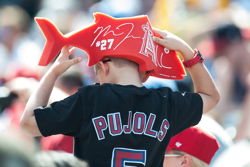 A young Angel fan adjusts his Mike Trout hat during the Angels' preseason game against the Chicago Cubs at Angel Stadium Sunday.<br /> <br /> <br /> ///ADDITIONAL INFO:   <br /> <br /> angels.0404.kjs  ---  Photo by KEVIN SULLIVAN / Orange County Register  --  4/3/16<br /> <br /> The Los Angeles Angels take on the Chicago Cubs at Angel Stadium during a preseason game at Angel Stadium Sunday.<br /> <br /> <br />  4/3/16