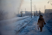 Street scene in the city of Khandyga located at the Kolyma highway in Yakutia about 10 hours driving time from Yakutsk. Khandyga (Russian: ???????) is a settlement in the Sakha Republic, Russia, located on the Aldan River. Population: 7,025 (2002 Census); 9,536 (1989 Census). It is on the northeast corner of the Aldan River where the river turns from north to west. A few miles downstream is the mouth of the Amga River. The community is on the Kolyma Highway 380 kilometres (236 mi) northeast of Yakutsk. Khandyga, Jakutien, Yakutia, Russian Federation, Russia, RUS, 18.01.2010.