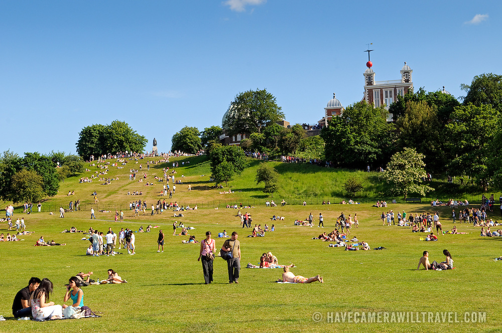 Greenwich Park on a sunny summer's day. At top right of frame is the  Royal Observatory with the Prime Meridian.