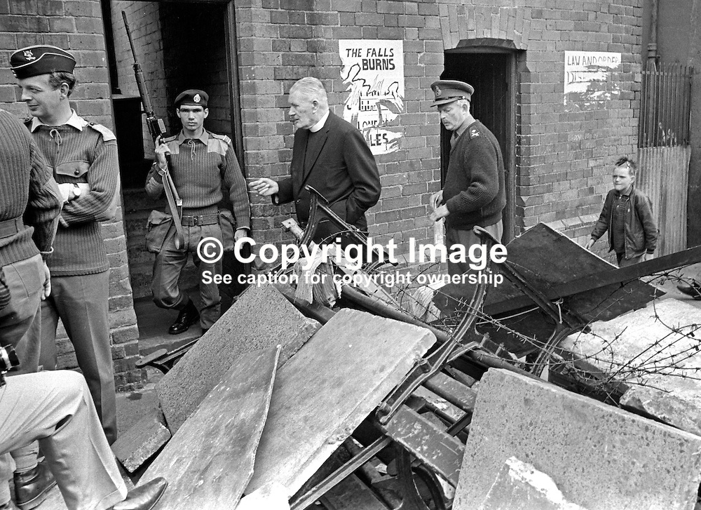 Father Padraig Murphy, St Peter's Roman Catholic Church, Falls Road, Belfast, N Ireland, UK, accompanied by Major General Tony Dyball, the British Army military commander in Belfast, tour the Falls Road area appealing for the removal of barricades. 196909160252b.<br /> <br /> Copyright Image from Victor Patterson, Belfast, UK<br /> <br /> t: +44 28 9066 1296 (from Rep of Ireland 048 9066 1296)<br /> m: +44 7802 353836<br /> e: victorpattersonbelfast@gmail.com<br /> <br /> www.images4media.com<br /> <br /> Please see my full Terms and Conditions of Use at https://www.images4media.com/p/terms-conditions - it is IMPORTANT that you familiarise yourself with them.<br /> <br /> Images used online incur an additional cost. This cost should be agreed in writing in advance. Online images must be visibly watermarked i.e. © Victor Patterson or that of the named photographer within the body of the image. The original metadata must not be deleted from images used online.<br /> <br /> This image is only available for the use of the download recipient i.e. television station, newspaper, magazine, book publisher, etc, and must not be passed on to a third party. It is also downloaded on condition that each and every usage is notified within 7 days to victorpattersonbelfast@gmail.com.<br /> <br /> The right of Victor Patterson (or the named photographer) to be identified as the author is asserted in accordance with The Copyright Designs And Patents Act (1988). All moral rights are asserted.