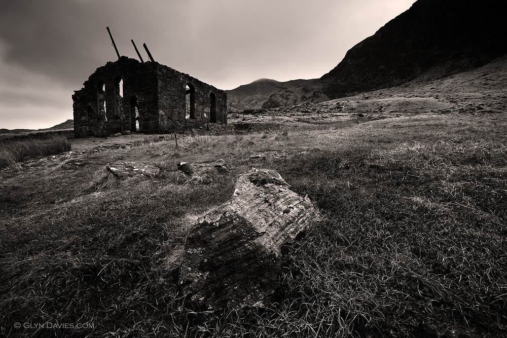 In an abandoned quarry village, high up in the windswept mountains of Wales, sits a derelict old chapel with it's roof timbers now collapsing inwards but still pointing skywards. It is only the spirit of the workmen in this busy slate quarry that remains, the valley is silent and desolate.