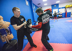 Students punching pads as Stef Noij, KMG Instructor from the Institute Krav Maga Netherlands, takes the IKMS G Level Programme seminar today at the Scottish Martial Arts Centre, Alloa.