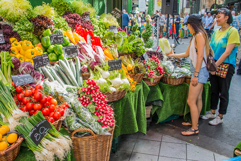 The vegetable stalls draw custom again - The market reopening is signified by the ringing of the bell and is attended by Mayor Sadiq Khan. Tourists and locals soon flood back to bring the area back to life.