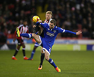 Mark Duffy of Sheffield Utd tussles with Josh Law of Oldham during the English League One match at Bramall Lane Stadium, Sheffield. Picture date: December 26th, 2016. Pic Simon Bellis/Sportimage