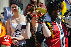 © Licensed to London News Pictures. 08/04/2017. London, UK. Participants sit on the steps of St Paul's Cathedral as they take part in the inaugural Games Character Parade, walking from Guildhall to Paternoster Square.  The event formed part of the London Games Festival welcoming cosplayers, wearing costumes inspired by videogame characters, to the UK's biggest parade of cosplayers.   Photo credit : Stephen Chung/LNP