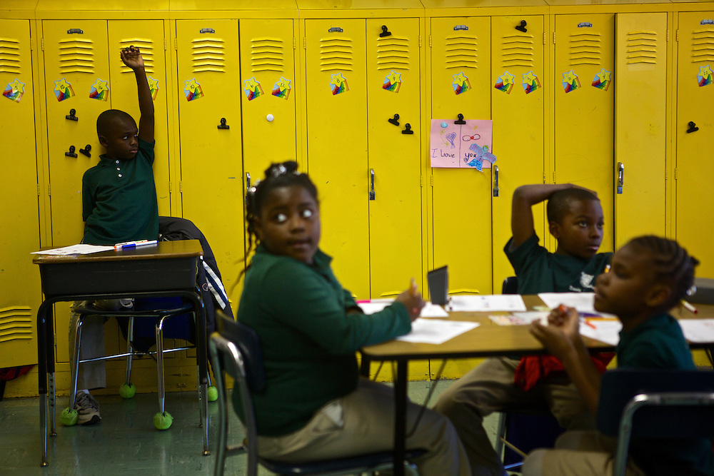 Third grader Marquet Williams, left, and other students listens to instructions from their teacher Courtney Jackson, left, at Adelaide Davis Elementary School on Nov. 26, 2012 in Washington, D.C. Last week DCPS Chancellor Kaya Henderson proposed closing 20 under-enrolled schools in the District. Davis Elementary is one of 20 schools in the DCPS system included in the school closure proposal. There are currently 178 students enrolled in Davis Elementary and the second floor of the school is only used for music classes and the library...CREDIT: Lexey Swall for The Wall Street Journal.DCSCHOOLS
