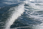 wave made by the wake of a motorboat