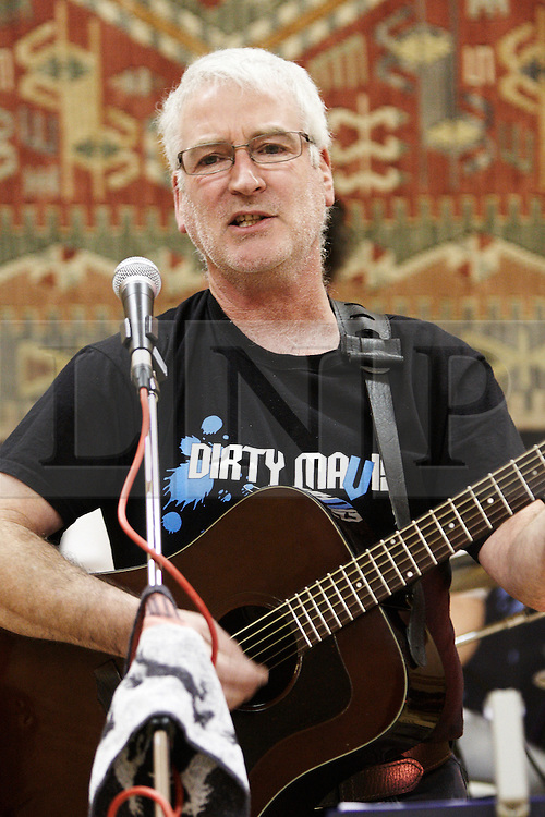 """© Licensed to London News Pictures.  17/12/2011. Buckinghamshire, UK. Martin Davis (pictured), lead singer of band Dirty Mavis performs The Oak Tree Lament (Did you stop the HS2), at the Stop HS2 Christmas party in Lacey Green. The protest song against the planned high speed railway between London and Birmingham that would devastate the Chilterns mocks the £17 billion cost as """"a pound for every leaf"""".  Martin, a footwear designer and salesmen, wrote the song in under an hour while commuting to work. The single is due to be released tomorrow (Mon 19th) in time for Christmas and bookmakers have quoted odds as low as 16-1 on it being Christmas #1. Half of the proceeds will go towards the Stop HS2 campaign. Photo credit: Cliff Hide/LNP"""