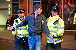 """© Licensed to London News Pictures . 24/12/2016 . Manchester , UK . Police detain a man , following a fight outside The Birdcage on Withy Grove . Revellers out in Manchester City Centre overnight during 2016's second """" Mad Friday """" , named for historically being one of the busiest nights of the year for the emergency services in the UK . Photo credit : Joel Goodman/LNP"""
