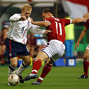 England's Paul Scholes tangles with Denmark's Ebbe Sand