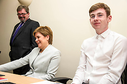 Pictured: Company Net Chief Executive Andy Hamilton ensures First Minister Nicola Sturgeon does not distract student Adam Fisher