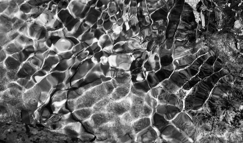Light is refracted through softly rippling water in a shallow stream, in the Mendocino forests of Northern California<br /> <br /> Prints: https://bit.ly/abstract-water-BW<br /> <br /> Learn more about the story behind this image on the blog: http://bit.ly/2N7Qo7N