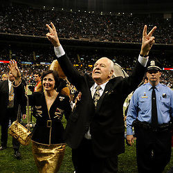 Jan 24, 2010; New Orleans, LA, USA; New Orleans Saints owner Tom Benson (right) and wife Gayle Benson (left) on the field prior to kickoff of a 31-28 overtime victory by the New Orleans Saints over the Minnesota Vikings in the 2010 NFC Championship game at the Louisiana Superdome. Mandatory Credit: Derick E. Hingle-US PRESSWIRE