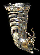 Fluted silver drinking horn (rhyton) with partial gilding, Achaemenid Persian, 5th-4th century BC. from Erzincan, Turkey. This elaborate silver vessel would originally have been used both as a drinking cup and as a pourer for wine. It was made in two parts and is decorated with the head and forequarters of a griffin. The pair of holes in the griffin's chest could be closed by the drinker's fingers, or opened to allow the wine to flow through. The wings and other parts are gilded.