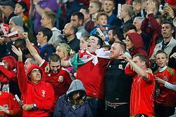 Wales fans celebrate after Wales win the match 1-0 to top their UEFA2016 Qualifying Group - Photo mandatory by-line: Rogan Thomson/JMP - 07966 386802 - 12/06/2015 - SPORT - FOOTBALL - Cardiff, Wales - Cardiff City Stadium - Wales v Belgium - EURO 2016 Qualifier.