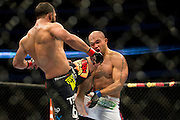 Johny Hendricks catches Robbie Lawler with a knee during UFC 171 at the American Airlines Center in Dallas, Texas on March 15, 2014.