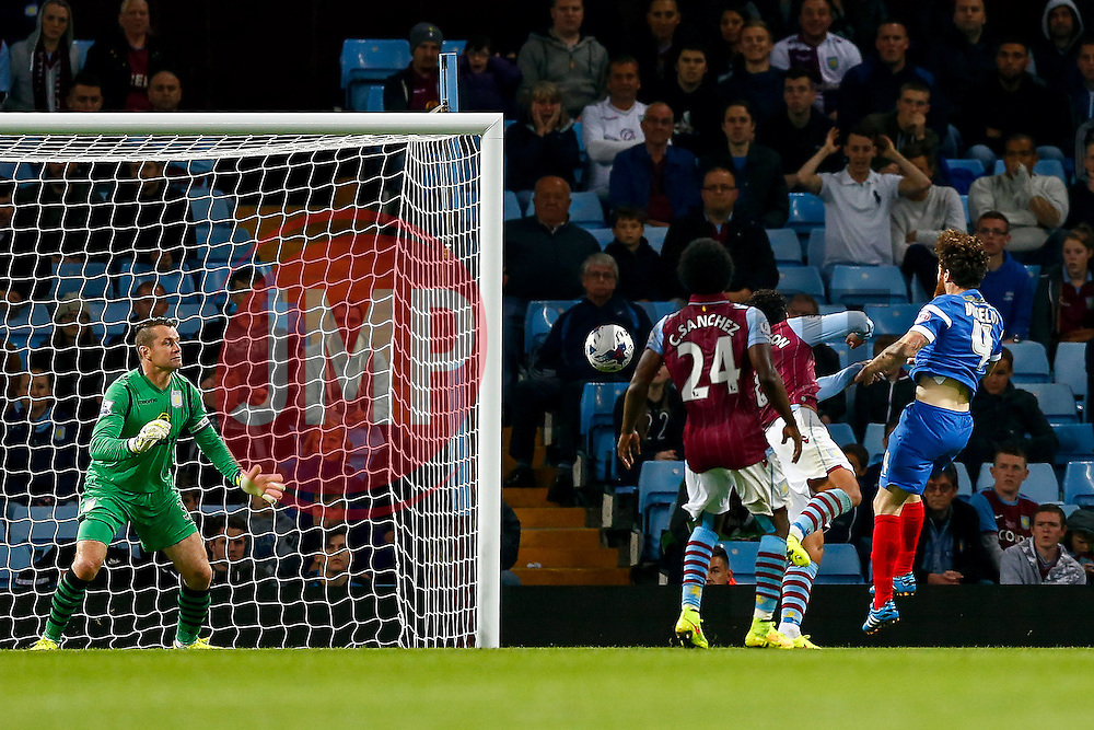 Romain Vincelot of Leyton Orient scores sending a shot Kieran Richardson and goalkeeper Shay Given of Aston Villa - Photo mandatory by-line: Rogan Thomson/JMP - 07966 386802 - 27/08/2014 - SPORT - FOOTBALL - Villa Park, Birmingham - Aston Villa v Leyton Orient - Capital One Cup Round 2.