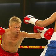COPENHAGEN 20021108 <br /> FIGHT NIGHT GALA - IBC and WBA WC-fight, Bantamweight. Johnny Bredahl, Denmark (L) and Leo Gamez, Venezuela fighting for the WC title in the Falconercentre Arena in Copenhagen November 8, 2002. <br /> PHOTO: LARS MOELLER/SCANPIX Code 92005