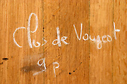 clos de vougeot in chalk hand writing on barrel clos des langres ardhuy nuits-st-georges cote de nuits burgundy france