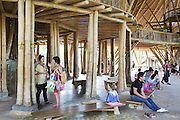 """Parents and staff talk together in the """"Heart of School""""<br /><br />The Green School (Bali) is one of a kind in Indonesia. It is a private, kindergarten to secondary International school located along the Ayung River near Ubud, Bali, Indonesia. The school buildings are of ecologically-sustainable design made primarily of bamboo, also using local grass and mud walls. There are over 600 students coming from over 40 countries with a percentage of scholarships for local Indonesian students.<br /><br />The impressive three-domed """"Heart of School Building"""" is 60 metres long and uses 2500 bamboo poles. The school also utilizes renewable building materials for some of its other needs, and almost everything, even the desks, chairs, some of the clothes and football goal posts are made of bamboo.<br /><br />The educational focus is on ecological sustainability. Subjects taught include English, mathematics and science, including ecology, the environment and sustainability, as well as the creative arts, global perspectives and environmental management. This educational establishment is unlike other international schools in Indonesia. <br /><br />Renewable energy sources, including solar power and hydroelectric vortex, provide over 50% of the energy needs of the school. The school has an organic permaculture system and prepares students to become stewards of the environment. <br /><br />The school was founded by John and Cynthia Hardy in 2008."""