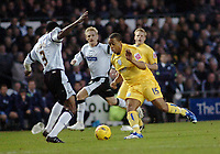 Photo: Kevin Poolman.<br />Derby County v Sheffield Wednesday. Coca Cola Championship. 13/01/2007. Wade Small of Wednesday looks for a way past Mo Camara of Derby.