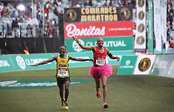 10062018 (Durban) Atlhetes celebrates at then finnish line during the 2018 Comrades marathon in Durban.<br /> Picture: Motshwari Mofokeng/ANA