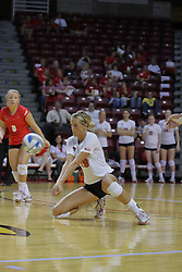 15 SEP 2009: Mallory Leggett goes to her knee to grab a dig. The Redbirds of Illinois State defeated the Cougars of Southern Illinois Edwardsville in 3 sets during play in the Redbird Classic on Doug Collins Court inside Redbird Arena in Normal Illinois