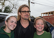 """Brad Pitt greets volunteer who work at his foundation  after giving   Ellen DeGeneres  a  tour in the """" Make it Right """" housing project in the Lower 9th Ward of New Orleans the day before a star-studded fundraising dinner  being held in New Orleans for his foundation."""