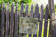 Rickety wooden gate forms gateway to private garden at Bossington, Exmoor, Somerset, UK