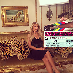 """Paris Hilton releases a photo on Instagram with the following caption: """"Hey #LittleHiltons! I'm shooting my documentary in #Ibiza July 13-16. \ud83c\udfb6\ud83c\udfa5\ud83d\udc78\ud83c\udffc\ud83c\udfb6 Post a video explaining the reasons you are my fan \u0026 why you should be in my film. You will also win tickets to my @FoamAndDiamonds Party at @AmnesiaIbiza. Hashtag your post with #ParisHiltonDocumentary \ud83d\udc8bLove you all!\ud83e\udd17"""". Photo Credit: Instagram *** No USA Distribution *** For Editorial Use Only *** Not to be Published in Books or Photo Books ***  Please note: Fees charged by the agency are for the agency's services only, and do not, nor are they intended to, convey to the user any ownership of Copyright or License in the material. The agency does not claim any ownership including but not limited to Copyright or License in the attached material. By publishing this material you expressly agree to indemnify and to hold the agency and its directors, shareholders and employees harmless from any loss, claims, damages, demands, expenses (including legal fees), or any causes of action or allegation against the agency arising out of or connected in any way with publication of the material."""