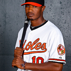 February 26, 2011; Sarasota, FL, USA; Baltimore Orioles center fielder Adam Jones (10) poses during photo day at Ed Smith Stadium.  Mandatory Credit: Derick E. Hingle