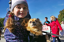 September 30, 2018 - Kyiv, Ukraine - A girl holds a brown lap dog during the nationwide march for animal rights, Poltava, central Ukraine, September 30, 2018. Ukrinform. (Credit Image: © Pustovit Serhii/Ukrinform via ZUMA Wire)