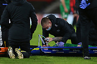 Football - 2020 / 2021 Sky Bet Championship - AFC Bournemouth vs. Preston North End - The Vitality Stadium<br /> <br /> Patrick Bauer of Preston takes on some gas and air before being lifted on to the stretcher at the Vitality Stadium (Dean Court) Bournemouth <br /> <br /> COLORSPORT/SHAUN BOGGUST