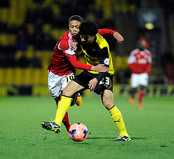 Watford's Iriney fouls Bristol City's Bobby Reid - Photo mandatory by-line: Dougie Allward/JMP - Tel: Mobile: 07966 386802 14/01/2014 - SPORT - FOOTBALL - Vicarage Road - Watford - Watford v Bristol City - FA Cup - Third Round - replay