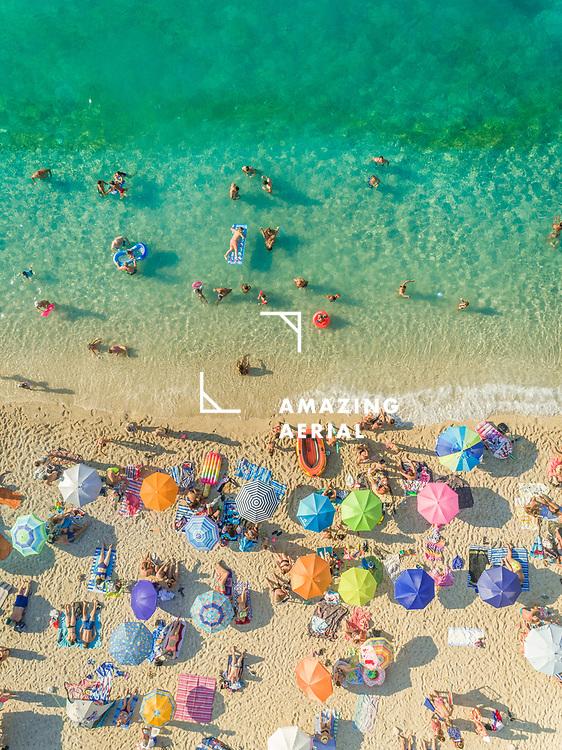 Aerial view of people on crowded beach enjoying summer, Lefkada, Greece.