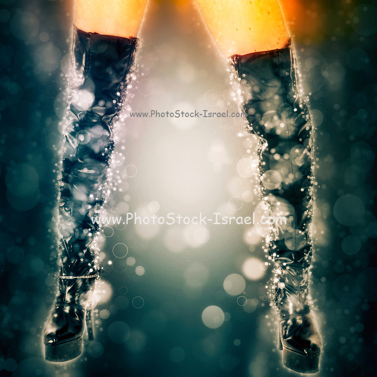 Digitally enhanced image of a 26 years old Fetish model in high heeled long black boots. Fashion glamour and fetish concept