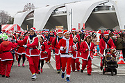 Participants take part in the Tokyo Great Santa Run in Komazawa-daigaku Olympic Park, Tokyo, Japan. Sunday December 22nd 2019, The great Santa Run was first run in Tokyo in 2018. This years run saw over 3,000 people in Santa costumes run and walk a 4.3 kilometre course to raise money for medical charities in japan and water projects for the Maasai in Kenya.