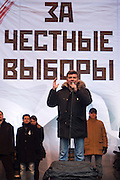 """Moscow, Russia, 24/12/2011..Opposition politician Boris Nemtsov speaks to an estimated crowd of up to 100,000 gathered to protest against election fraud and Prime Minister Vladimir Putin in the largest anti-government demonstration in Russia since the collapse of the Soviet Union. The banner behind reads """"For Honest Elections""""."""