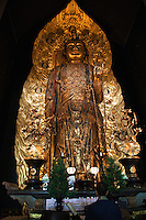 """The magnificent statue of Hase Kannon is housed here for all to see and worship. It is 9 meters pr 30 feet tall and has eleven heads in addition to its main one - three in front, three to the left and three to the right, plus one at the top and another on the back. Each face has a different expression, signifying that the deity listens to the wishes of all types of people. Gold leaf was applied to the statue in 1342 and in 1392 the halo was added. Although Kannon is usually described in English as """"the Buddhist Goddess of Mercy"""" strictly speaking it is neither masculine nor feminine and represents compassion, mercy, and love."""