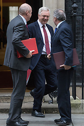 Downing Street, London, January 10th 2017. Work and Pensions Secretary Damian Green (left), Secretary of State for Exiting the European Union David Davis and International Trade Secretary Liam Fox (right) leave the weekly UK cabinet meeting at 10 Downing Street as the new Parliamentary term begins.