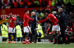 Manchester United's Jesse Lingard is replaced by Marouane Fellaini during the Emirates FA Cup, quarter final match at Old Trafford, Manchester.