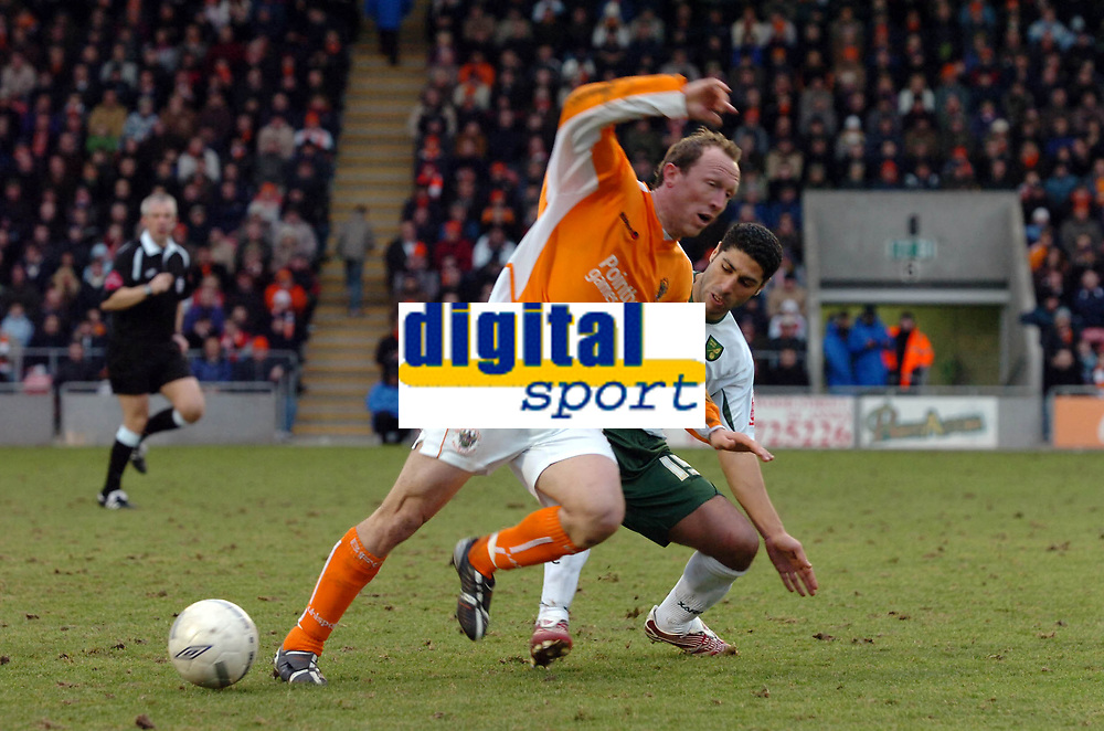 Photo: Paul Greenwood.<br />Blackpool v Norwich City. The FA Cup. 27/01/2007. Blackpool's Andy Morrell, left, beats Youssef Safri to the ball
