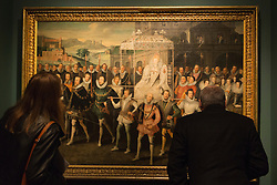 "© Licensed to London News Pictures. 09/10/2013. London, England. Visitors look at the ""Procession Portrait of Queen Elizabeth"" by an Unknown Artist. Press preview of the exhibition ""Elizabeth I & Her People"" at the National Portrait Gallery which explores the remarkable reign of Elizabeth I through the lives and portraiture of her subjects. Exhibition runs from 10 October 2013 to 5 January 2014. Photo credit: Bettina Strenske/LNP"