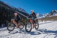 Erin and Jon Delk of Aspen ride fat bikes on Maroon Creek Road in Aspen, Colorado.