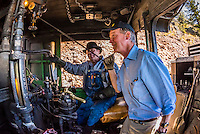 Governor John Hickenlooper (of Colorado) riding in the steam locomotive, pulls the train whistle, on a visit aboard the the Cumbres & Toltec Scenic Railroad, from Antonito to Osier, Colorado during peak autumn color. The Cumbres & Toltec Scenic Railroad has been jointly owned by the States of Colorado and New Mexico since 1970 when it was purchased from the Denver and Rio Grande Western Railway, which was going to scrap the line. The train makes a 64 mile run between Antonito, Colorado and Chama, New Mexico. The railroad is the highest and longest narrow gauge steam railroad in the United States with a track length of 64 miles. The train traverses the border between Colorado and New Mexico, crossing back and forth between the two states 11 times. The narrow gauge track is 3 feet wide. It runs over 10,015 ft (3,053 m) Cumbres Pass.