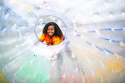 © Licensed to London News Pictures . 12/08/2018. Manchester , UK . MARLIE McKENZIE (five, from Hulme) . The second day of the annual Caribbean Carnival in Alexandra Park in Moss Side , celebrating music , food and Afro-Caribbean culture . A nearby shooting overnight lead to at least ten people injured . Ten people are in hospital . Photo credit : Joel Goodman/LNP