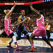 Maya Moore, (centre), Minnesota Lynx, is fouled as she drives to the basket defended by Katie Douglas, (left), and Ebony Hoffman, Connecticut Sun, during the Connecticut Sun Vs Minnesota Lynx, WNBA regular season game at Mohegan Sun Arena, Uncasville, Connecticut, USA. 27th July 2014. Photo Tim Clayton