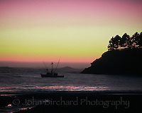 Salmon fishing boat at sunset in Little River Bay, Mendocino County, CA..CD scan from 35mm chrome.  © John Birchard