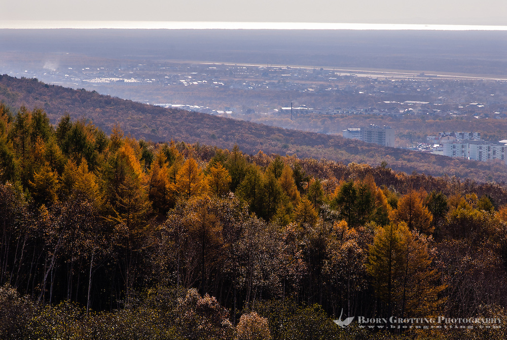 Russia, Sakhalin, Yuzhno-Sakhalinsk. City view from the Gorny Vozdukh Ski center lift.