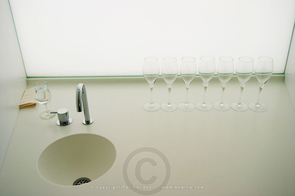 Analytical wine tasting in a neutral white environment a white desk a sink and a backlit white screen with a line of empty champagne glasses at the Maison de la Champagne (the House of the Champagne Region), the head quarters of CIVC (Comite Interprofessionnel du Vin de Champagne) in Epernay, Champagne, Marne, Ardennes, France